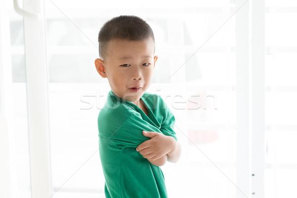 Asian boy grimacing Stock photo © szefei