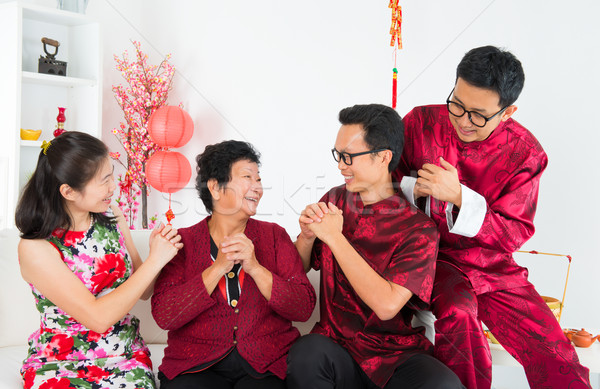 Happy Asian family reunion Stock photo © szefei