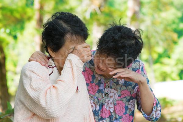 Sad senior Asian women Stock photo © szefei