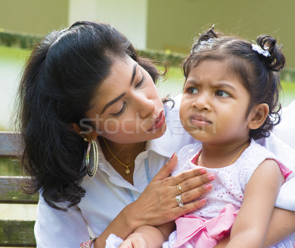 Mother comforting upset Indian girl Stock photo © szefei