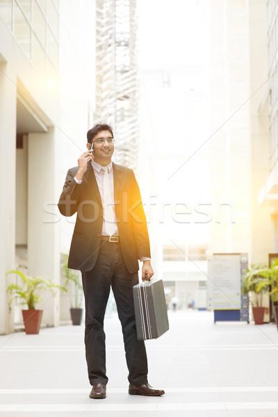 Asian Indian businessman full length using smartphone Stock photo © szefei