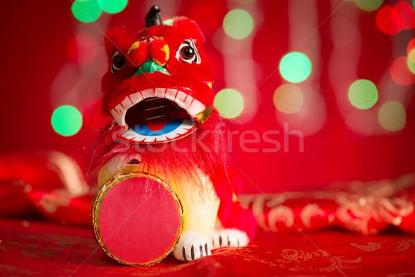 Chinese New Year decorations miniature dancing lion Stock photo © szefei