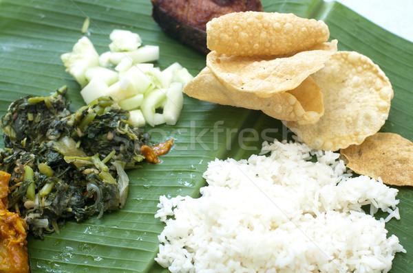 Culinária indiana banana folha delicioso comida arroz Foto stock © szefei