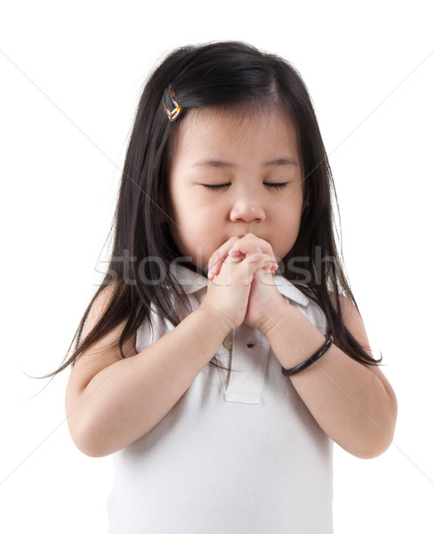 Praying girl Stock photo © szefei