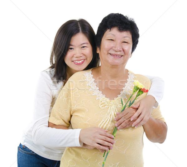 Boldog anyák napját lánygyermek szegfű virágok anya fehér Stock fotó © szefei