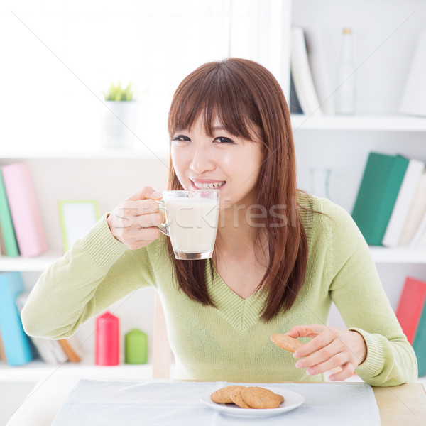 Asian female drinking milk Stock photo © szefei