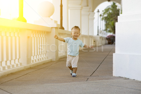 Asian toddler running at outdoor Stock photo © szefei
