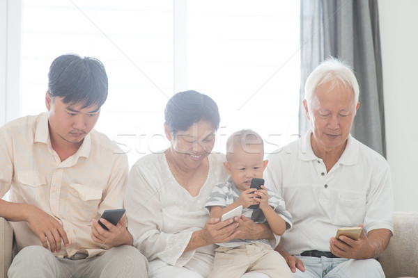 Family addicted with smart phones Stock photo © szefei