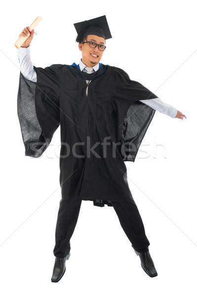 ázsiai férfi egyetemi hallgató érettségi talár ugrik Stock fotó © szefei
