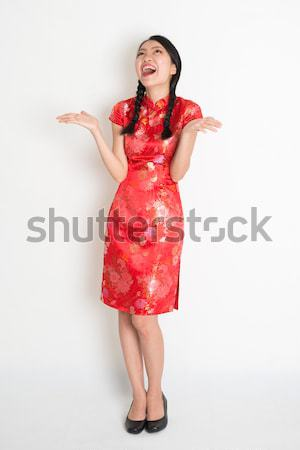 Excited Asian chinese girl looking up Stock photo © szefei