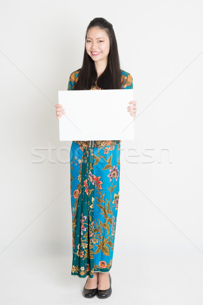 Asian girl holding white card Stock photo © szefei