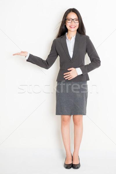 Asian businesswoman showing something Stock photo © szefei