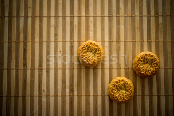 Mooncakes on bamboo mat with copy space low light Stock photo © szefei