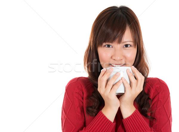 Asian woman drinking coffee or tea Stock photo © szefei