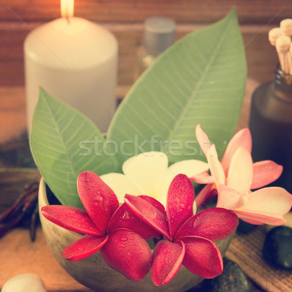 Tropical spa with Frangipani flowers Stock photo © szefei