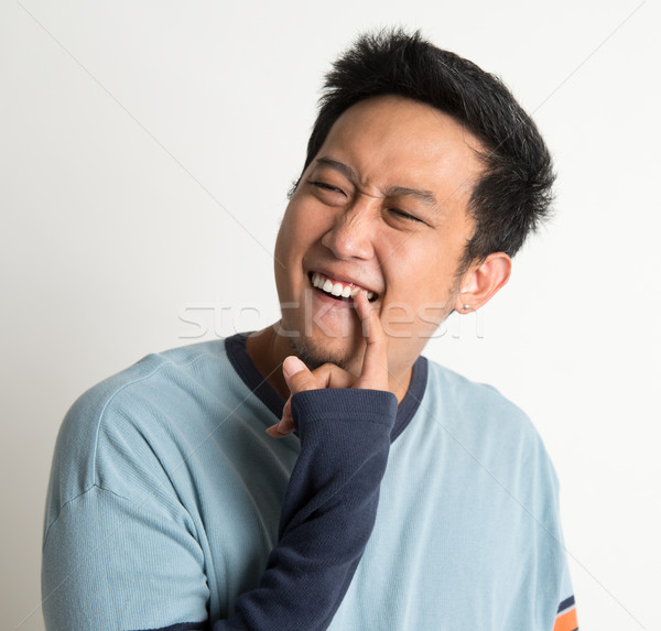 Something stuck in teeth Stock photo © szefei