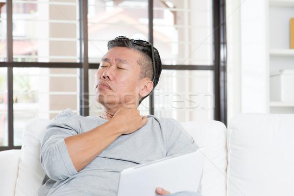 Dojrzały asian człowiek ból barku portret Zdjęcia stock © szefei