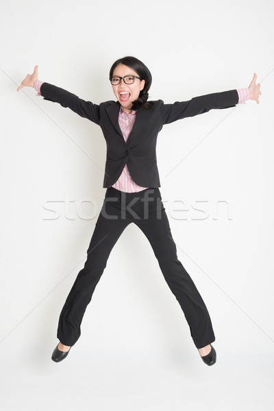 Business woman leaping high in the air Stock photo © szefei