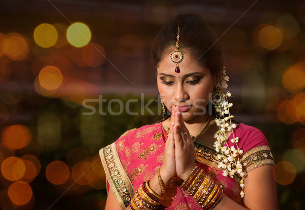 Indian girl praying Stock photo © szefei