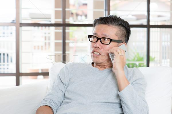 成熟した アジア 男 呼び出し スマートフォン 現代 ストックフォト © szefei