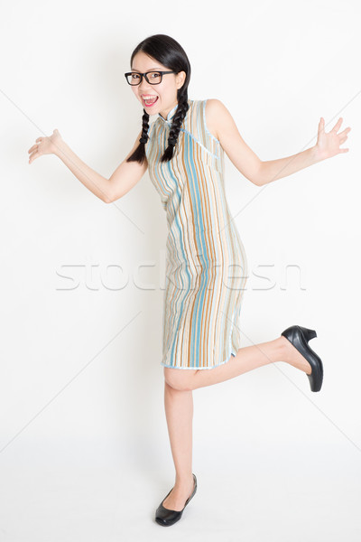 Excited Asian girl jumping around Stock photo © szefei