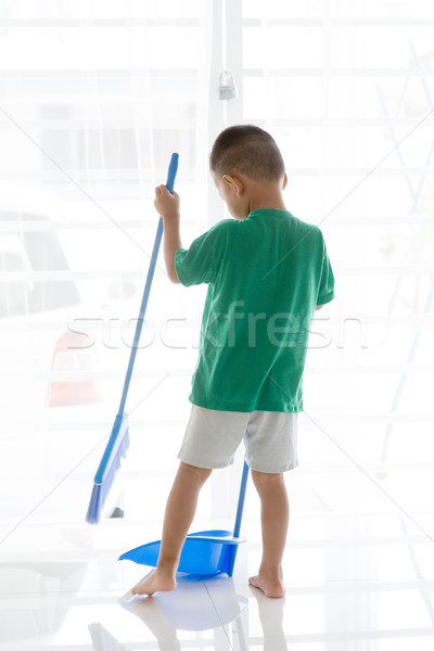 Asian boy sweeping floor Stock photo © szefei