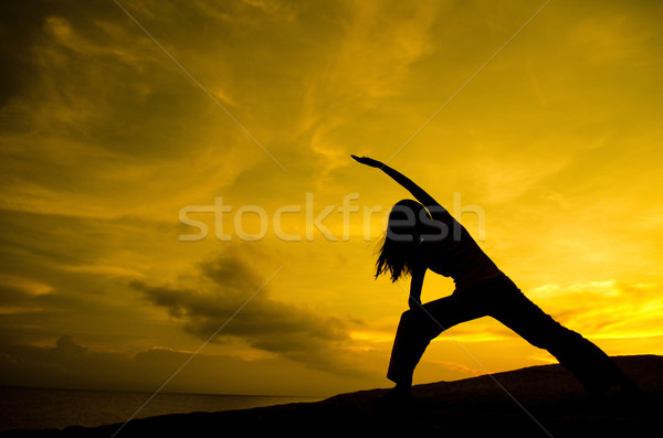 Yoga nature silhouette femme guerrier Photo stock © szefei