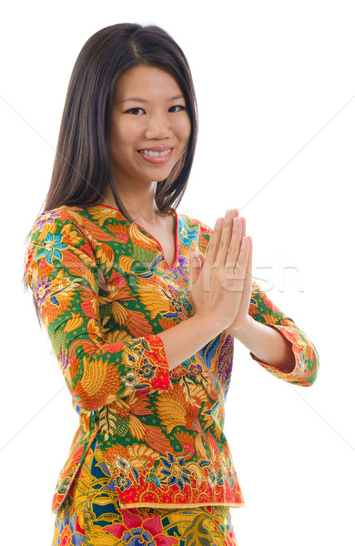 Délkelet ázsiai lány üdvözlet hagyományos kézmozdulat Stock fotó © szefei