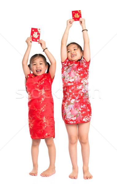 Happy Asian children holding red packet Stock photo © szefei
