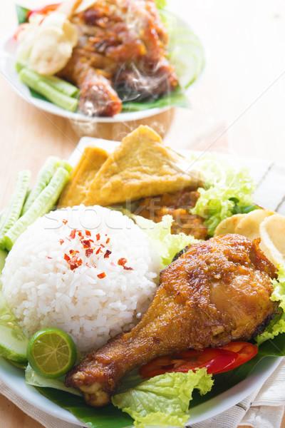 Malaysian food nasi ayam penyet Stock photo © szefei