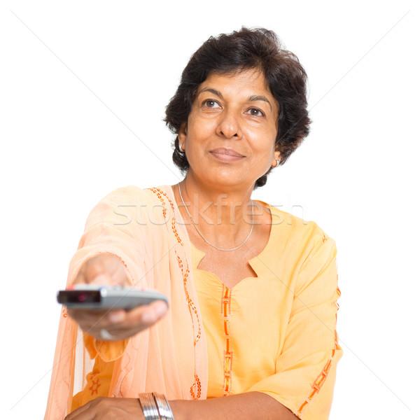 Indian mature woman watching tv Stock photo © szefei