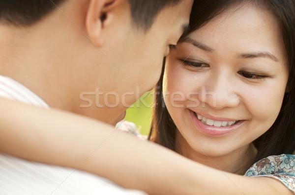 Szeretet suttog szerető pár szemtől szembe szabadtér Stock fotó © szefei