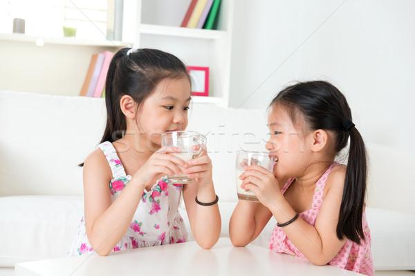 Children drinking milk.  Stock photo © szefei