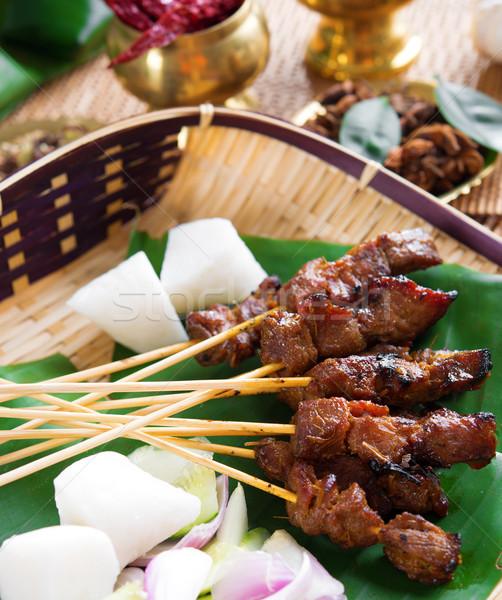 Beef satay Stock photo © szefei