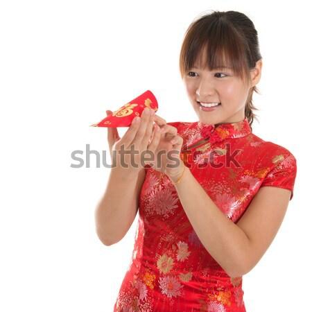 Side view Chinese cheongsam girl greeting Stock photo © szefei