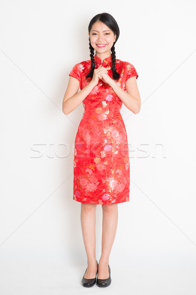 Asiático chinês menina saudação feliz ano novo chinês Foto stock © szefei