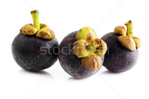 Мангостин три фрукты изолированный белый здоровья Сток-фото © szefei