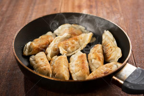 Fried dumpling in cooking pan Stock photo © szefei
