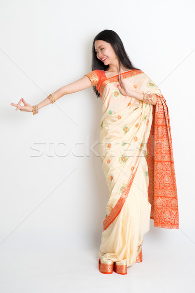 Woman in Indian sari dress dancing Stock photo © szefei