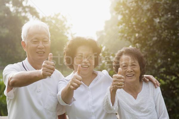 Group of Asian seniors giving thumbs up Stock photo © szefei