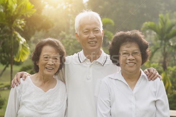 Stock photo: Asian seniors group at outdoor park