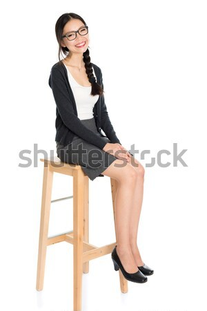 Fullbody young Asian female seated Stock photo © szefei