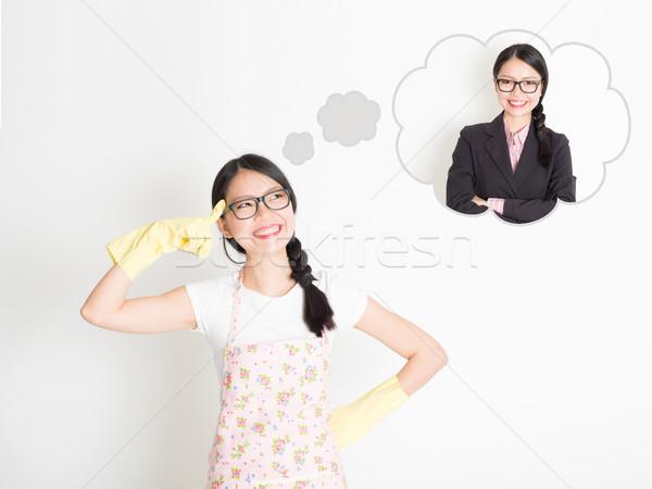 Housewife dreaming of changing job  Stock photo © szefei