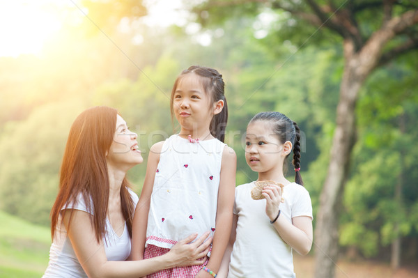 Mother and daughters at outdoors park. Stock photo © szefei