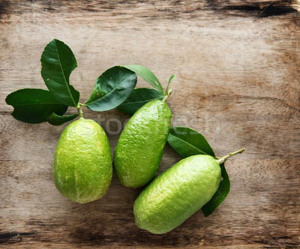 Fresh organic lemons top view Stock photo © szefei