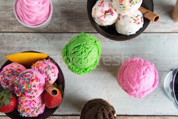 Various flavor ice cream bowl top view Stock photo © szefei