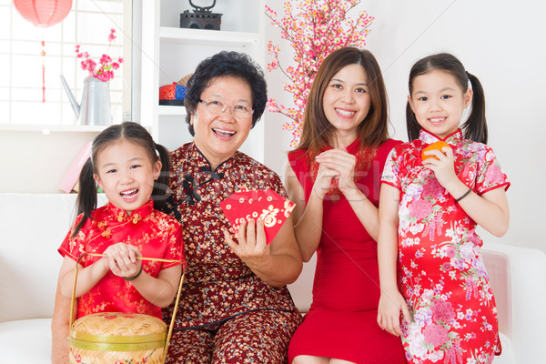 Multi generations Asian family celebrate Chinese new year Stock photo © szefei
