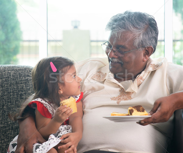 Grandparent and grandchild eating cake Stock photo © szefei