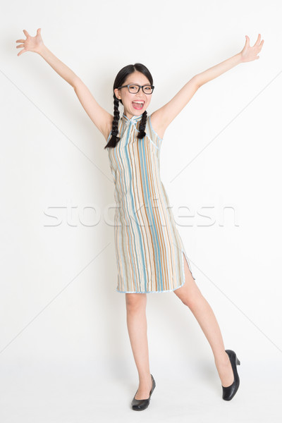 Stock photo: Asian Chinese girl arms outstretched