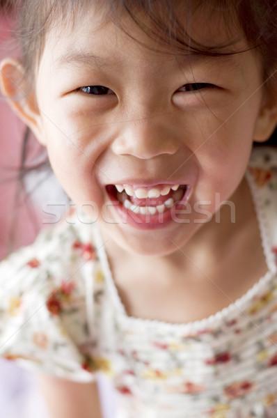 Cara feliz retrato pequeño Asia nina mujer Foto stock © szefei